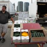 Man standing with boxes of zuchini