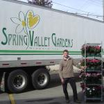 Spring Valley Gardens truck, man with rack of flowering plants