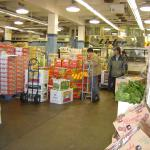 inside view - stacks of boxes with produce, trolleys
