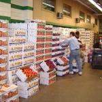 stacks of boxes of produce along a wall